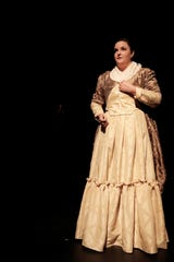 "Amber Glasgow portrays playwright Olympe de Gouges in the San Juan College Theatre production of ""The Revolutionists."""