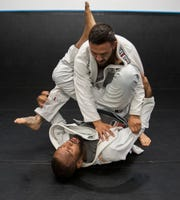Cub Swanson, in top position, and Joshua Dubinsky are photographed in early September during a training session in the Coachella Valley.