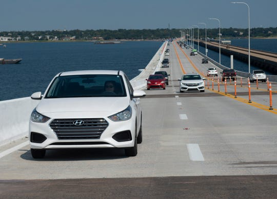 Police say that because the new Pensacola Bay Bridge does not have a center barrier wall separating eastbound and westbound traffic, it is likely officers will have to stop traffic in both directions while responding to major crashes, like the one on Sunday that shut down traffic for more than two hours.