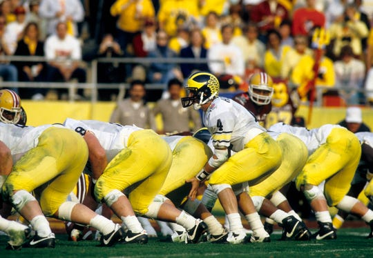 Michigan Wolverines quarterback Jim Harbaugh (4) prepares for the snap against the Arizona State Sun Devils during the 1987 Rose Bowl. The Sun Devils defeated the Wolverines 22-15.