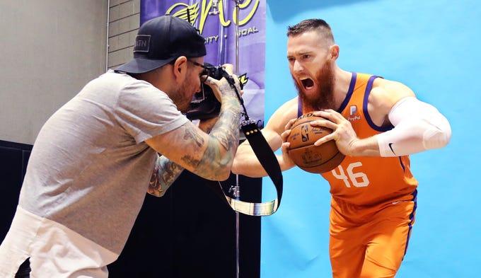 Photographer Michael Anthony Gonzales shoots Phoenix Suns center forward Aron Baynes at Phoenix Suns Media Day at Talking Stick Resort Arena, Monday, September 30, 2019.