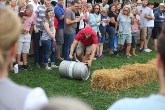 Guests enjoy fun traditional games provided by the Bavarian Sports Club, based out of Toledo, at Twin Oast Brewing's Oastoberfest celebration at Catawba Island on Saturday.