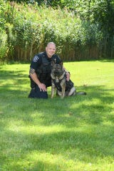 Marysville Officer Justin Reeves with Heiko, the department's first and only police dog.
