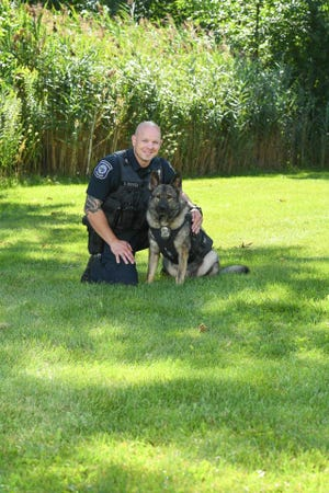 Marysville police dog handler Justin Reeves with Heiko, the department's first and only dog.