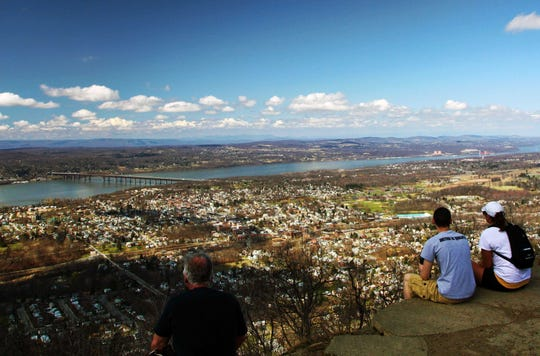 Hikers look out from the Mount Beacon Railway Incline overlooking Beacon and the Newburgh Beacon Bridge.