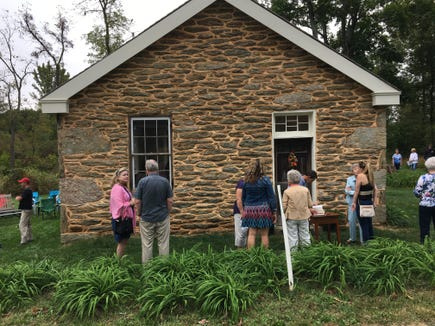 Friends and family attend a recent open house of the restored mid-1800s Hyson School in Hopewell Township.