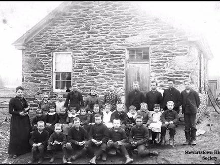 Students pose for picture day at the school in 1890, a couple of years before its closing.