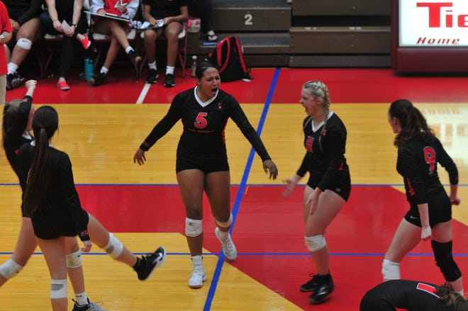 Richmond High School celebrates during a 3-0 win over Rushville on senior night on Monday, Sep. 30, 2019.