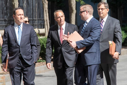 Former U.S. Rep. Chris Collins, center, arrives at Federal court, Tuesday, Oct. 1, 2019, in New York. Collins is expected to plead guilty in an insider trading case Tuesday, a day after saying he was quitting Congress.
