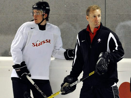 Ralph Krueger, then head coach of Switzerland's national ice hockey team, right, and Roman Josi attend a  practice session ahead of the 2009 IIHF World Championships.