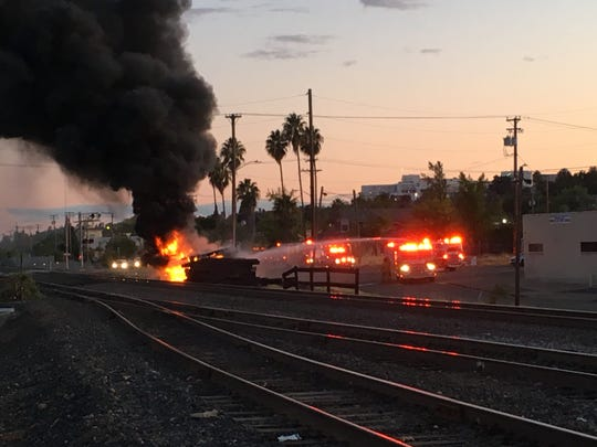 A pile of railroad ties caught fire Monday night, Sept. 30, 2019 in downtown Redding.