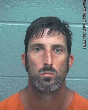 This photo provided by the Midland County Sheriff's Office shows Troy Lee Wilson. Wilson has been arrested after authorities say he killed one person and injured another when he opened fire several times last week on people whose vehicles stalled in the Odessa area of West Texas. Wilson of Odessa was arrested and charged Friday, Sept. 27, 2019, with murder and evading arrest. The 36-year-old remained jailed Tuesday on $550,000 bond. An affidavit says that in four incidents last week Wilson shot at people after offering to help with their vehicles.