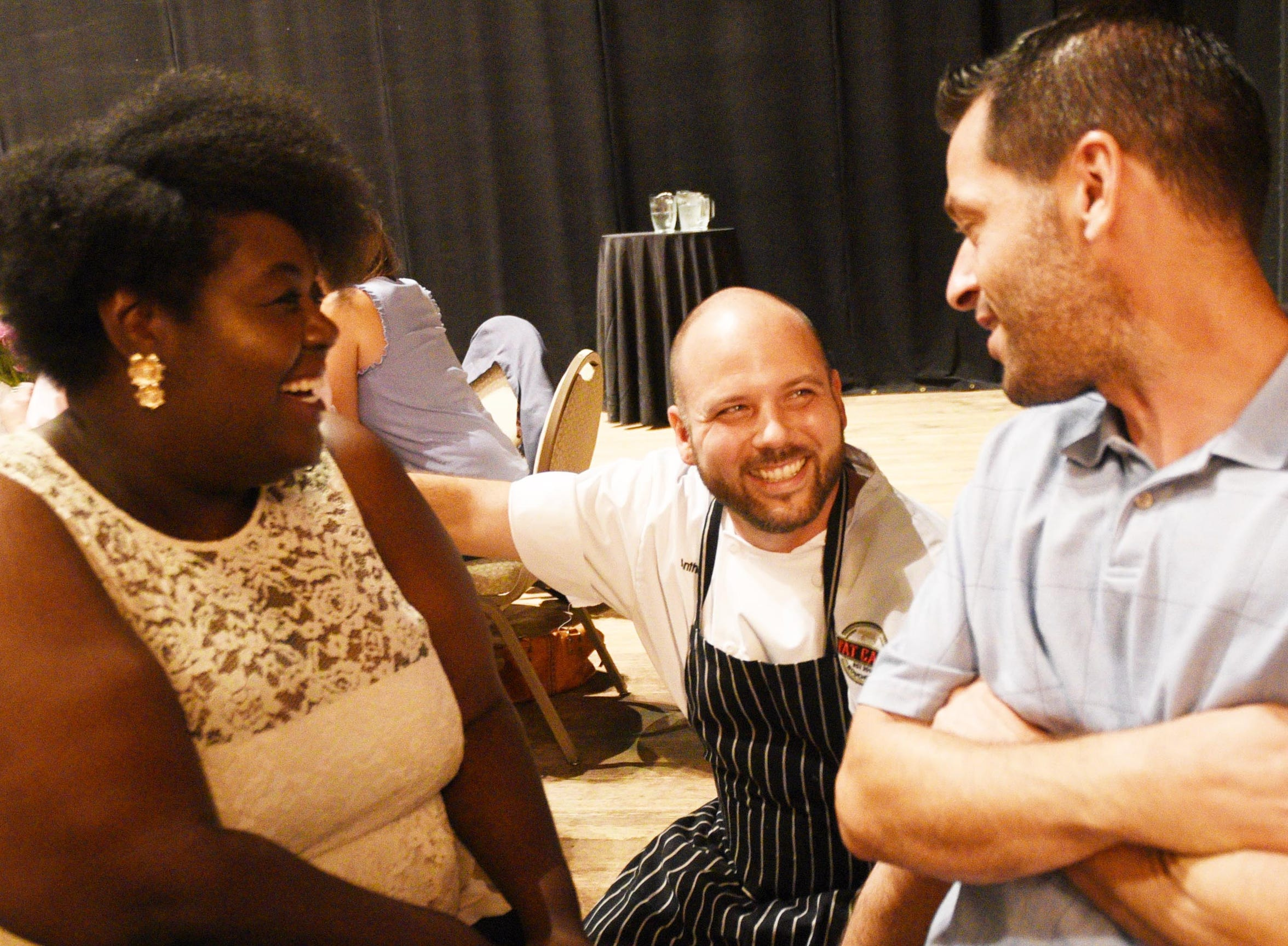 Chef Anthony Felan talks to Jada Durden, left, and Billy Campbell during the Second Act Supper Club recent dinner at the Shreveport Municipal Auditorium.