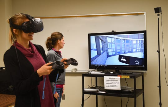 Argus Leader reporter Danielle Ferguson experiences a virtual reality tour of the the still-incomplete renovations and additions to the Minnehaha County Jail on Tuesday, October 1, in Sioux Falls.