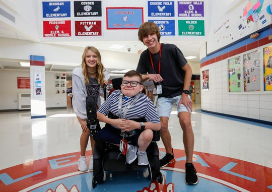 Collin Langston, center, is getting a lot of support from his classmates Lilly Wead, left, and Ian Williams. All three are freshmen at Glendale High School.