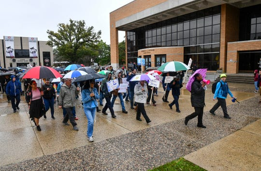 Students and faculty members take part in a march and rally to protest a decision by St. Cloud State University to lay off eight faculty members Tuesday, Oct. 1, 2019, in St. Cloud.