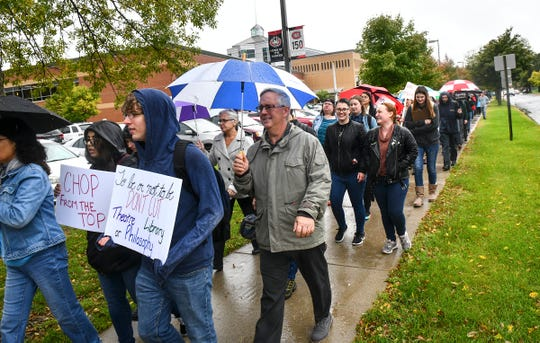 A march was organized by the St. Cloud State Faculty Association to protest  a decision by St. Cloud State University to lay off eight faculty members Tuesday, Oct. 1, 2019, in St. Cloud.