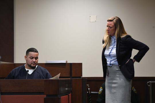 Assistant State Attorney Georgia Cappleman presents evidence to Luis Rivera as River testifies in the trial of his lifelong friend Sigfredo Garcia and Garcia's girlfriend Katherine Magbanua for the 2014 murder of Florida State University law professor Dan Markel at the Leon County Courthouse Tuesday, Oct. 1, 2019.