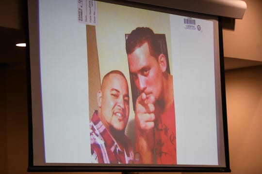 Luis Rivera identifies himself and Sigfredo Garcia in a photo being displayed during the trial of Garcia and Katherine Magbanua for the 2014 murder of Florida State University law professor Dan Markel at the Leon County Courthouse Tuesday, Oct. 1, 2019.