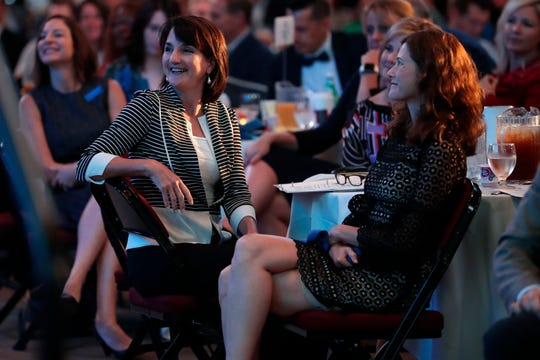 Sue Dick, president and CEO of the Tallahassee Chamber of Commerce, laughs at a joke made by President and CEO of Tallahassee Memorial HealthCare Mark O'Bryant.