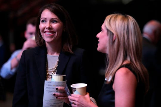 Cristina Paredes, director of the Leon County Office of Economic Vitality,  chats with a fellow Tallahassee Chamber member at the annual breakfast Tuesday, Oct. 1, 2019.