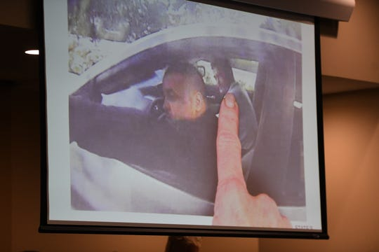 Assistant State Attorney Georgia Cappleman displays a photo showing Luis Rivera and Sigfredo Garcia using an ATM in Pembroke Pines during Garcia's trial for the 2014 murder of Florida State University law professor Dan Markel at the Leon County Courthouse Tuesday, Oct. 1, 2019.