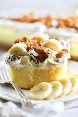 Banana Pudding Poke Cake is made with a sheet cake with holes poked in it.