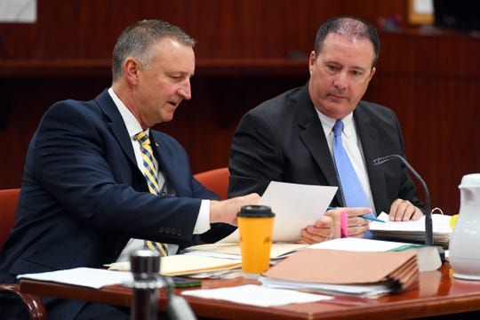 Chief Assistant State Attorney Thomas Bakkedahl (left) and Assistant State Attorney Brian Workman look over notes on Tuesday, Oct. 1, 2019, as attorneys begin to question potential jurors for the murder trial of Michael Jones, accused of killing his girlfriend Diana Duve in 2014. Jones, 36, is charged with first-degree murder and could receive the death penalty if convicted.