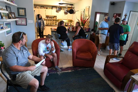 Lott family and friends gather together at the home of Betty and Phillip Lott in Fort Pierce Tuesday, Oct. 1, 2019, as Fort Pierce Police detectives search for Phillip Lott, 71, who went missing on Saturday, Sept. 28.
