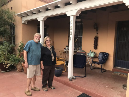 Doug Reed and Claudia Rivers stand by their front porch in Sunset Heights. The home will be part of the 16th annual Sunset Heights Tour of Homes.