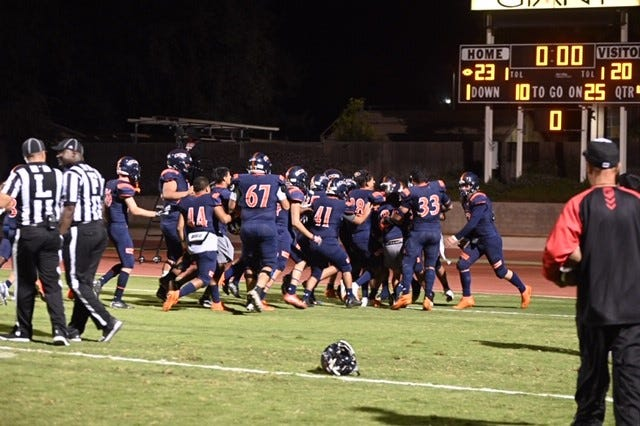 The COS football team celebrates after its overtime win on Saturday at Mineral King Bowl.