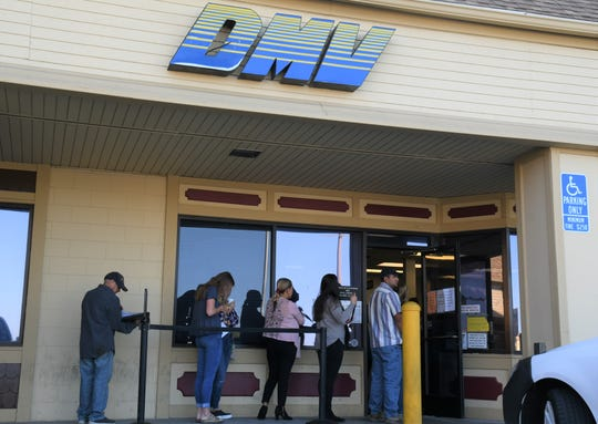 Customers at the Tulare Department of Motor Vehicles line out the door on Tuesday morning, Oct. 1.