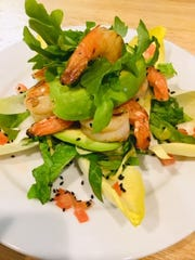 Grilled shrimp with garlic cloves, salt, lime juice, olive oil, fresh cilantro and avocado at Le Moulin Eatery and Wine Bar in Yonkers.