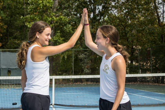 Clarkstown South's Nicole (left) and Samantha Svantner have compiled a 12-0 record in doubles play, they haven't lost a set in 20 matches.