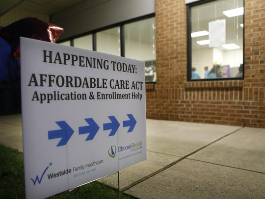 A sign points the way during an Affordable Care Act sign-up event at Westside Family Healthcare's location in the Fox Run Shopping Center in Bear in 2014.