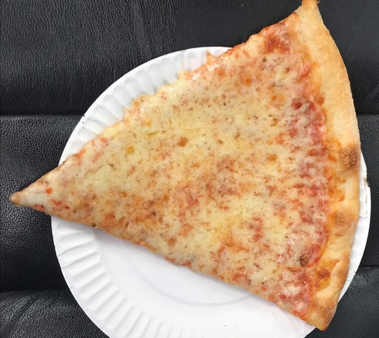 A crispy slice of cheese pizza at Tony & Dominick's near Prices Corner is $2.