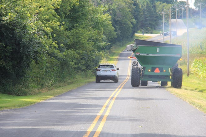 Since 2014, it has been illegal to pass farm equipment, in a no-passing zone regardless of the speed the equipment is traveling.