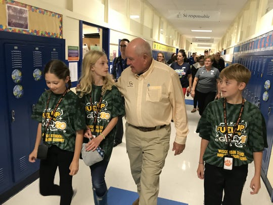 U.S. Ag Secretary Sonny Perdue talks to firth grader Grace Wertz and her involvement in the Fuel Up to Play 60 program at Sugar Creek Elementary School in Verona, Wis., on Oct. 1, 2019.