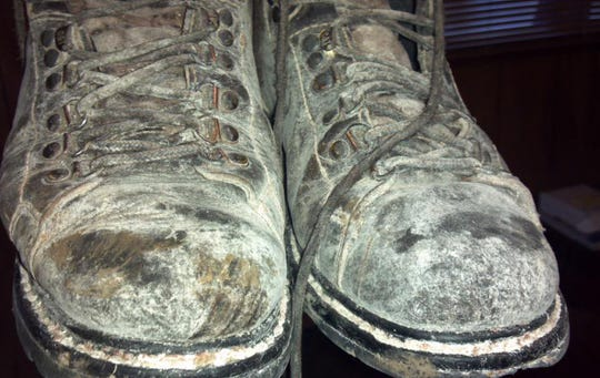 """The boots worn by Baker """"...my right foot received the highest pressure per square inch and was swollen so bad we thought it might need amputation. No matter what, I was alive..."""" he recalled."""