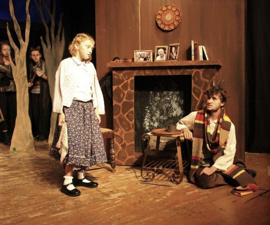 "Lilly Crawford as Lucy and Thomas Hoover as Mr. Tumnus  in a scene from ""The Lion, the Witch and the Wardrobe"" opening at the Renner Theatre."