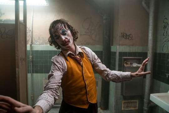 "Arthur Fleck (Joaquin Phoenix) moves to the music in his head in ""Joker."""