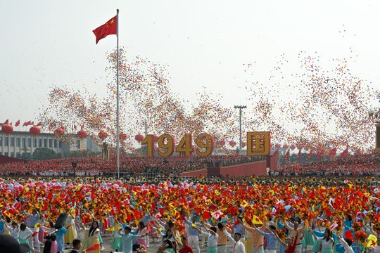 BEIJING, CHINA - OCTOBER 01: Balloons are released in the air at the end of the military parade for the 70th anniversary of the establishment of the People's Republic of China, on October 01, 2019 in  at Tiananmen Square, Beijing, China.