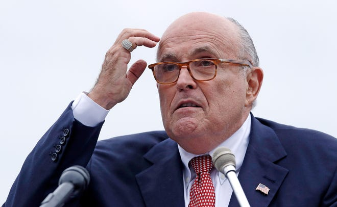 FILE - In this Aug. 1, 2018 file photo, Rudy Giuliani, attorney for President Donald Trump, addresses a gathering during a campaign event in Portsmouth, N.H. House committees have subpoena Giuliani for documents related to Ukraine. (AP Photo/Charles Krupa, File ) ORG XMIT: WX105
