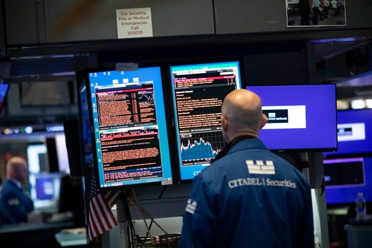 Monitors display the ebb and flow of money at the New York Stock Exchange.