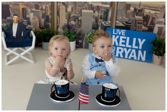 "Emalyn Wolanin, 15 months and Jaxon Hashemi, 11 months, were cast to be Kelly Ripa and Ryan Seacrest in photographer Ute Cowan's ""Live with Kelly and Ryan""-themed photo series."