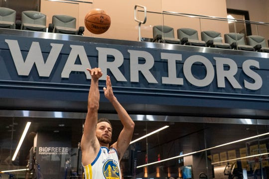 Golden State Warriors guard Stephen Curry shoots during Media Day at Chase Center.