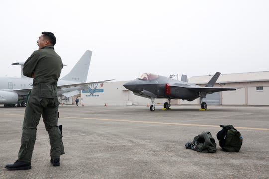A South Korean fighter pilot stands next his F-35 A Stealth jet fighter during the 71th anniversary of Armed Forces Day at the Military Air Base in Daegu, South Korea, 01 October 2019.