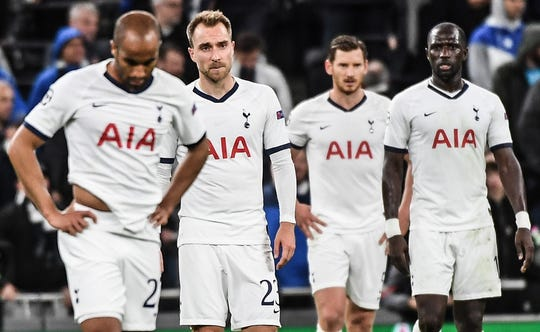 Tottenham players react after Tuesday's 7-2 loss at home to Bayern Munich.