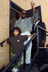 Kanye West and son Saint at his Sunday Service concert at The Greater Allen A.M.E. Cathedral of New York on Sept. 29.