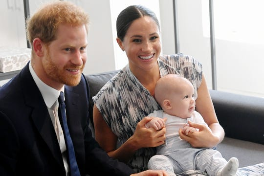 Prince Harry, Duchess Meghan and their baby son, Archie Mountbatten-Windsor, during their royal tour of South Africa on Sept. 25.